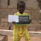 bambino sostenuto a toubab Dialaw2
